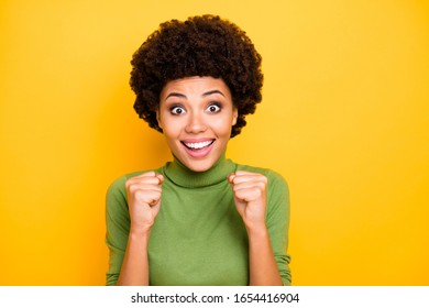 Close up portrait of cheerful cute charming pretty nice girlfriend smiling toothily making fists overjoyed about her victorious event isolated bright color background