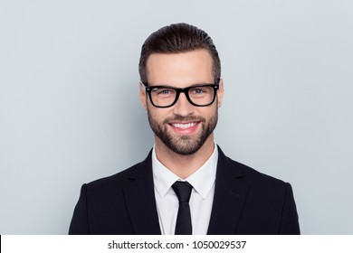 Close up portrait of cheerful delightful joyful confident self-assured kind friendly with beaming shiny smile modern hairstyle trainee isolated on gray background white shirt tie necktie