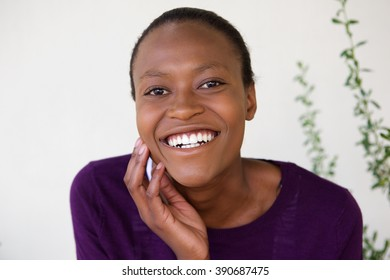 Close up portrait of cheerful young african woman face