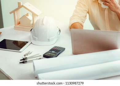 Close up portrait of civil engineer using laptop to  planning project schedule., Engineering and co nstruction concept.