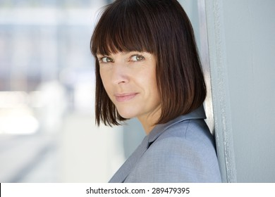 Close up portrait of a confident business woman with serious expression