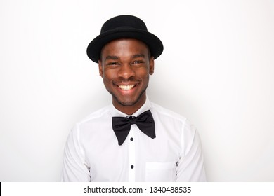 Close up portrait of cool african american man smiling with bowtie and hat