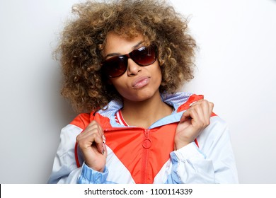 Close up portrait of cool young black woman with sunglasses