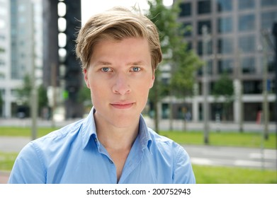 Close up portrait of a cool young businessman posing outdoors