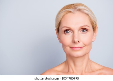 Close up portrait with copy space, empty place for product, advertisement concept, charming, pretty, attractive woman with perfect skin after cream, balm, mask, lotion, isolated on grey background