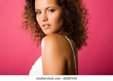 a close up portrait of a curly girl