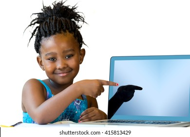 Close up portrait of cute african girl pointing at blank laptop screen.Isolated on white background.