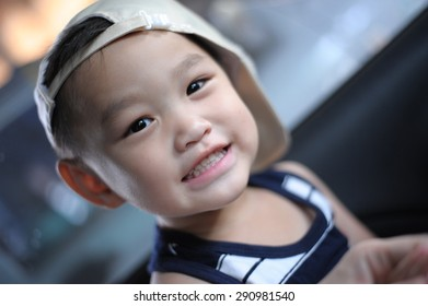 close up portrait of cute asian boy smiling