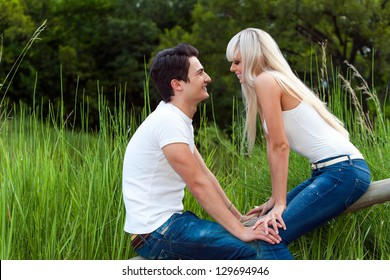 Close up portrait of cute couple on date in park.