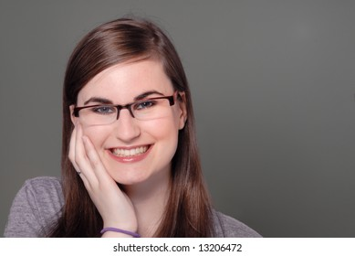close portrait of cute girl wearing spectacles smiling