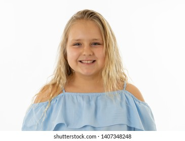 Close up portrait. Cute happy, confident, successful, proud little girl smiling at the camera. Positive human emotions and facial expressions, education and happy childhood concept.