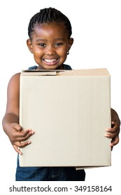 Close up portrait of cute little african girl with braided hairstyle holding big cardboard box.Isolated on white background.