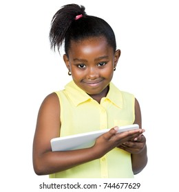 Close up portrait of cute little african girl with ponytail holding digital tablet.Smiling kid looking at camera Isolated on white background.