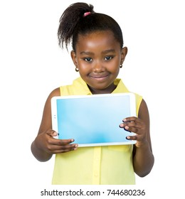 Close up portrait of cute little african girl with ponytail holding blank digital tablet.Isolated on white background.