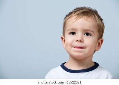 Close up portrait of cute little boy on background