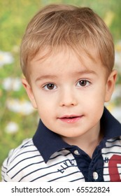 Close up portrait of cute little boy on natural background