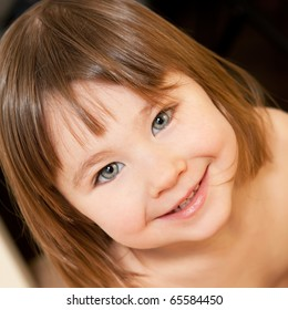 Close up portrait of a cute little girl indoors