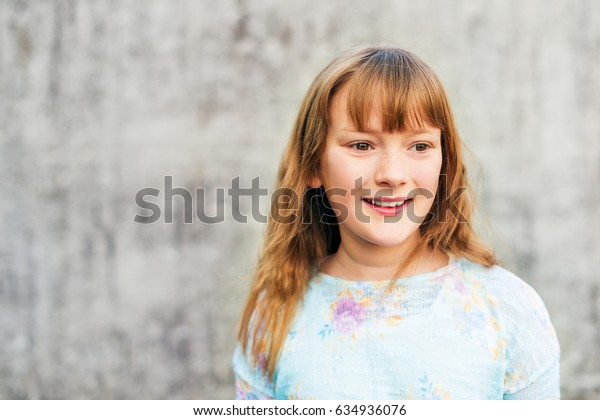 Close up portrait of a cute little girl of 8-9 year old