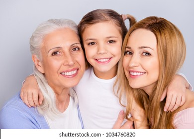 Close up portrait of cute nice friendly lovely adorable beautiful with toothy beaming smile embracing family isolated on gray background