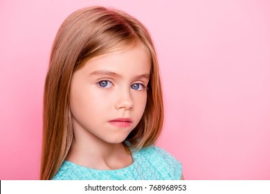 Close up portrait of cute nice lovely charming adorable beautiful confident concentrated little girl with big blue eyes, isolated on pink background, copyspace