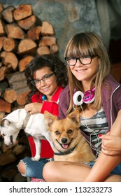 Close up portrait of cute teenage girlfriends with their dogs.
