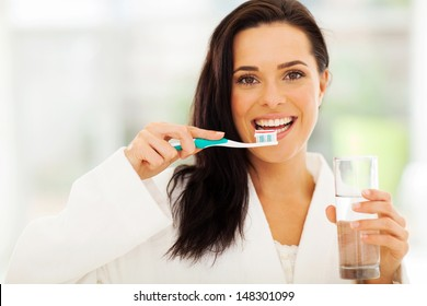 close up portrait of cute woman brushes her teeth