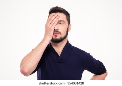 Close up portrait of disappointed stressed bearded young man in sweetshirt with closed eyes over white background