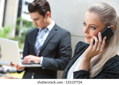 Close up portrait of elegant businesswoman talking on smart phone at outdoor meeting.