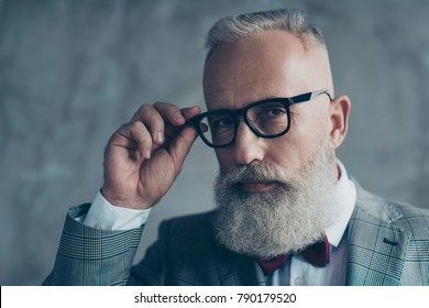 Close up portrait of elegant rich confident smart with modern hairdress haircut white beard creative virile dreamy luxurious pensive freelancer touching black rim-glasses isolated on grey background