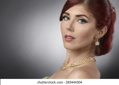 Close up portrait of an elegant young woman with bridal make up and hairstyle