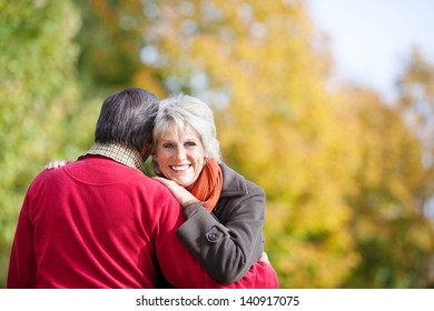 Close up portrait of embracing mature couple in the park