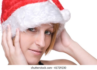 Close up portrait of emotional girl in santa claus hat