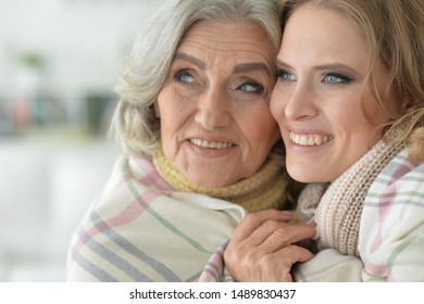 Close up portrait of enior woman with daughter