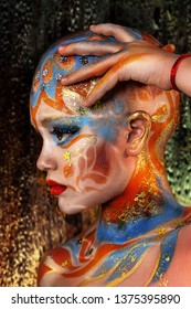 close up portrait of ethnic colorful girl. professional creative  makeup. face painting. brave little girl wins head cancer. beautiful little model struggling with the disease. head after chemotherapy