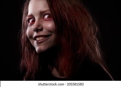 Close up portrait of evil girl possessed by a demon