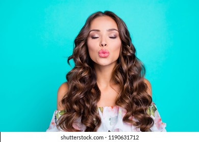 Close up portrait of exquisite, delicate, winsome, lovable, fascinating woman send a kiss isolated on bright turquoise background