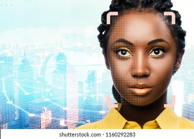 Close up portrait of facial recognition grid on african woman against city background.