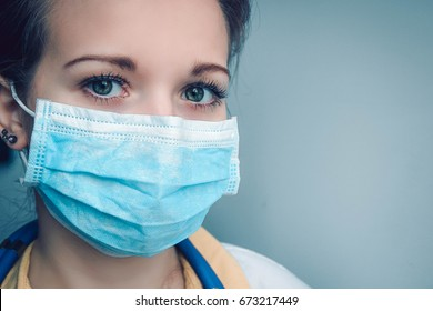 Close up portrait of female doctor or nurse wearing protective mask