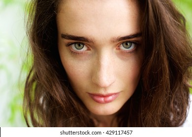 Close up portrait of female fashion model with green eyes