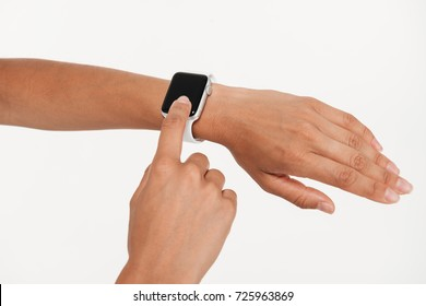 Close up portrait of female hands using wrist smart watch isolated over white background