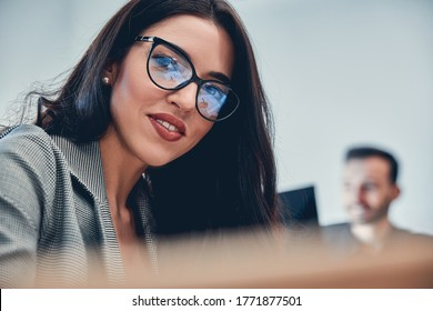 Close up portrait of friendly businesswoman in the office smiling at camera