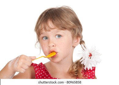 Close up  portrait of funny lovely 4 years little girl eat, spoon with honey with flower in hair on head, isolated over white background
