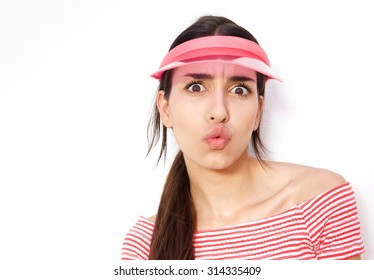 Close up portrait of a girl with cap afraid of giving a kiss