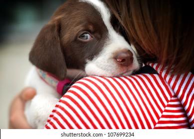 close up portrait of girl hugging dog
