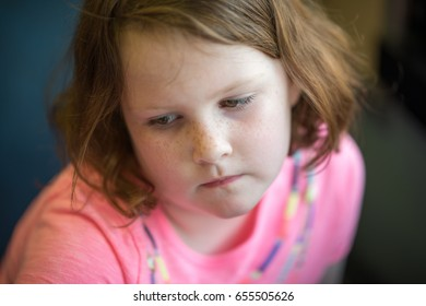 Close Portrait of Girl Thinking Sitting Down