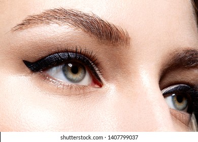 Close up portrait of girls with perfect makeup. Long eyelashes emphasize graceful clarity of model charms. Lady looking away calmly. Beauty and cosmetics concept