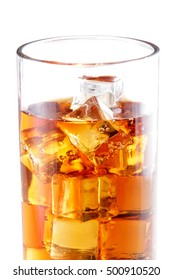 close up portrait of a glass of ice tea with many ice cubes isolated on white background