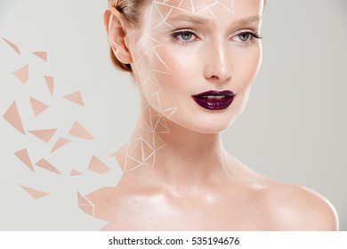 Close up portrait of glossy model with body art. isolated gray background.