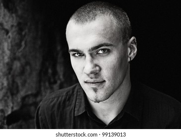 Close portrait of good looking young man. Outdoors photo