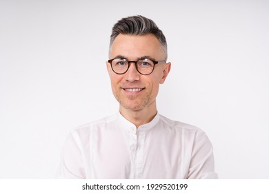 Close up portrait of a good-looking mature white businessman wearing glasses isolated in white background